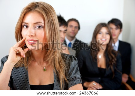 business woman and her team in an office - stock photo