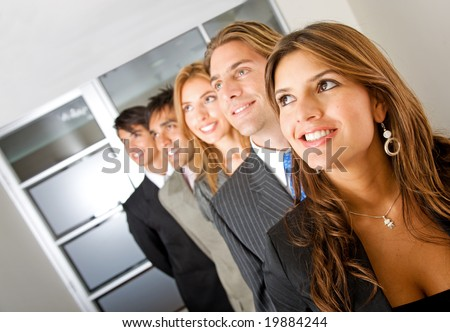 business woman and her team looking away in an office