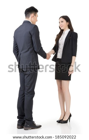 Business woman and man shake hands, full length portrait isolated on white background. - stock photo