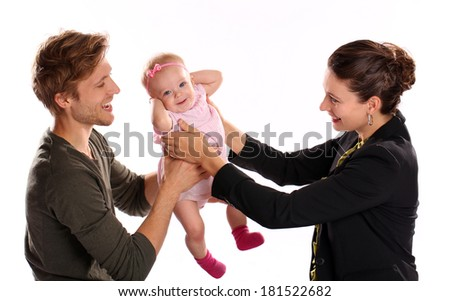 Business woman and mother handing child to stay at home father  - stock photo