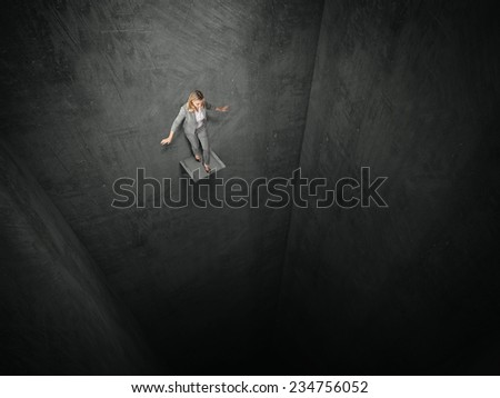 business woman and vertical tunnel prison - stock photo