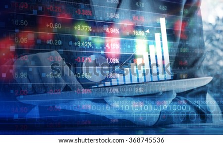 Business woman are checking stock market graph on digital tablet