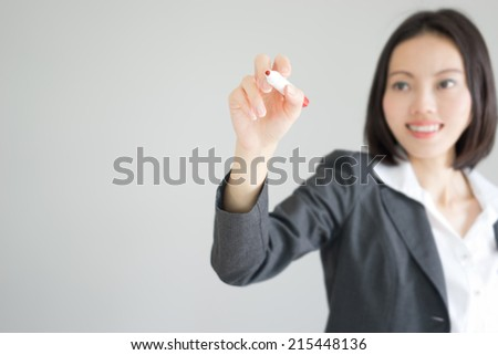 Business Woman Asian Writing - stock photo