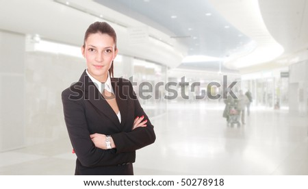 Business woman at the shopping mall - stock photo