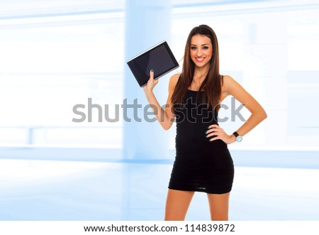 Business woman at work using a computer tablet - stock photo