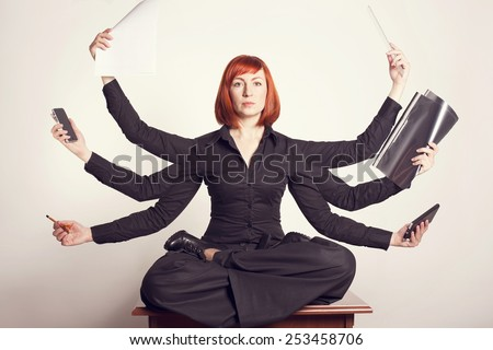 Business woman at work. Woman in the office. Woman - master. Have time to do much. Woman many hands. - stock photo