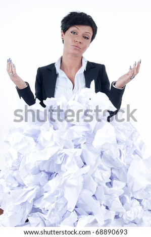business woman behind a pile of crumpled paper - stock photo