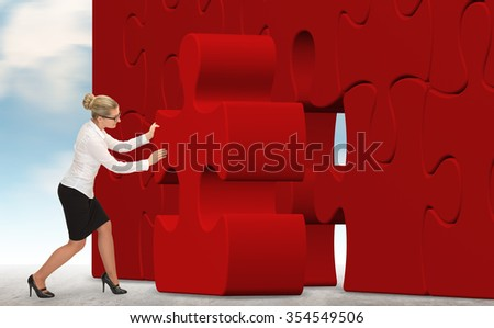 business woman building a red puzzle on a sky background  - stock photo