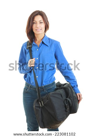 Business woman carrying a suitcase going on vacation - stock photo
