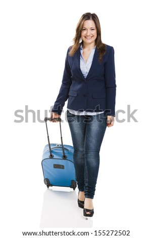 Business woman carrying a suitcase, isolated over white background - stock photo