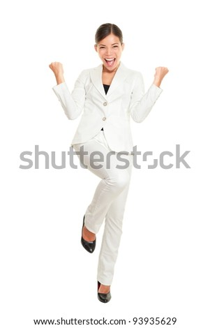 Business woman celebrating happy cheerful in white suit in full body. Cheering winner in joyful dance over success. Young multiracial Chinese Asian Caucasian businesswoman isolated on white background - stock photo