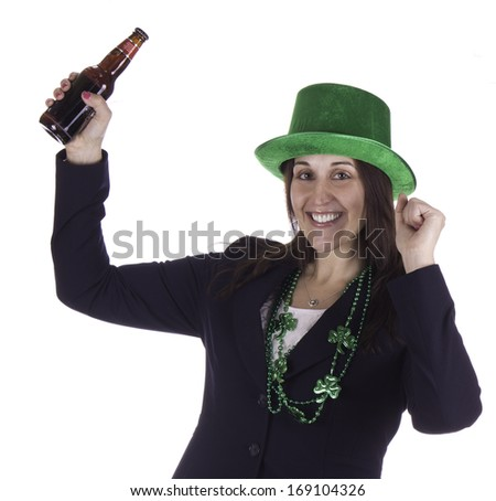 Business woman celebrating St. Patrick's Day with a beer