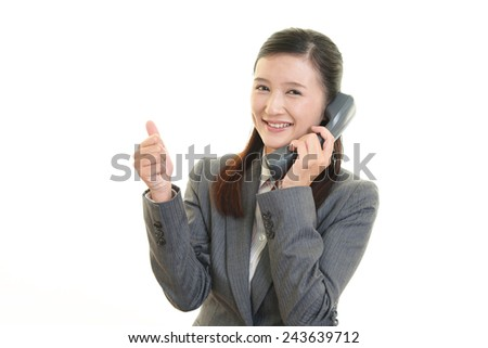 Business woman cheering - stock photo