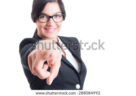 Business woman choosing or blaming me by poiting and aiming finger at the camera - stock photo