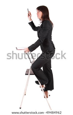 Business woman climbing ladder, isolated over white - stock photo