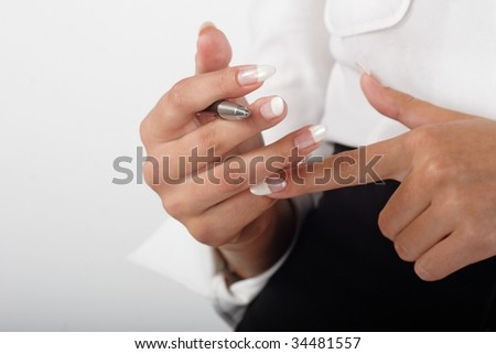 business woman counting holding a pen