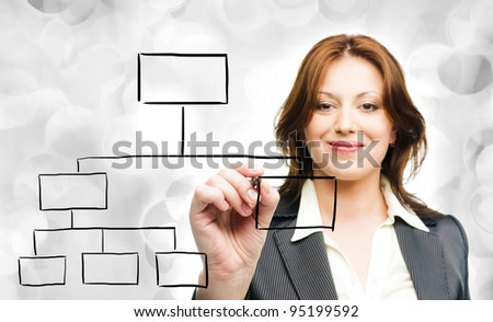 Business woman designing a plan on screen  on grey holiday lights - stock photo