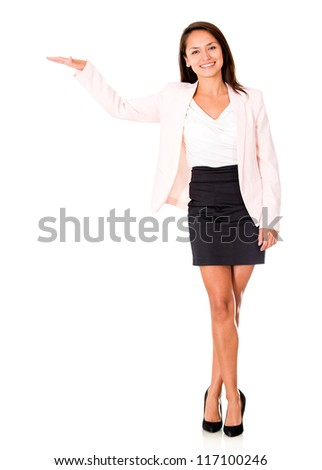 Business woman displaying something with her hand - isolated over white - stock photo