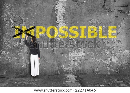 business woman drawing impossible concept - stock photo