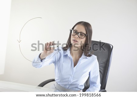 Business woman drawing on whiteboard