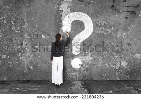 business woman drawing question mark - stock photo