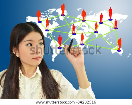 Business woman drawing social network on world map - stock photo