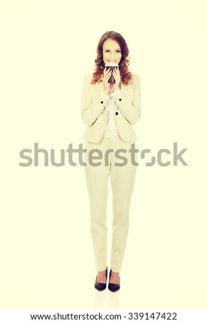 Business woman drinking coffee from paper cup.  - stock photo
