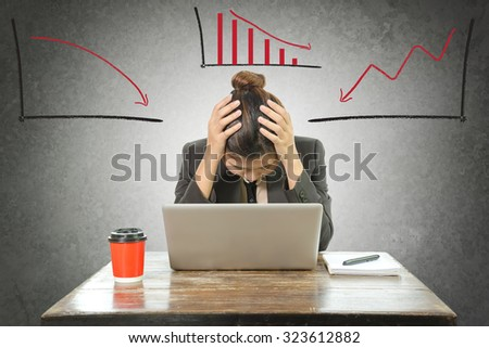 Business woman emotional desperate with  chart going down on wall background. - stock photo