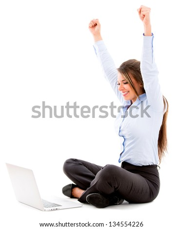 Business woman enjoying her online success - isolated over white - stock photo
