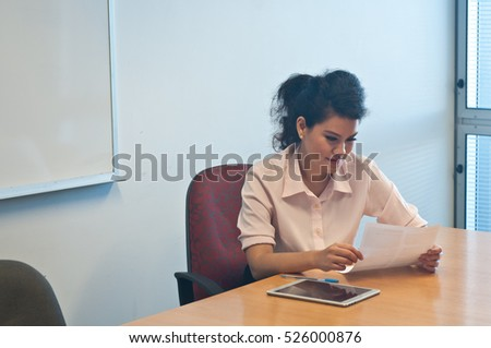 Business woman examining contract agreement in office