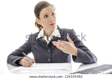 Business woman explaining something at office desk. Isolated over white background.
