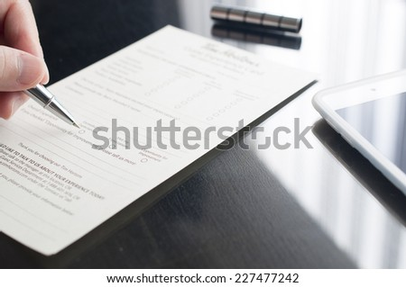 Business woman filling gusest experience card - stock photo