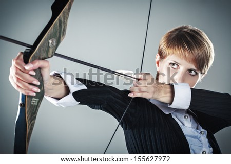 Business woman focused on target  - stock photo