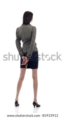 Business woman from the back - looking at something over a white background