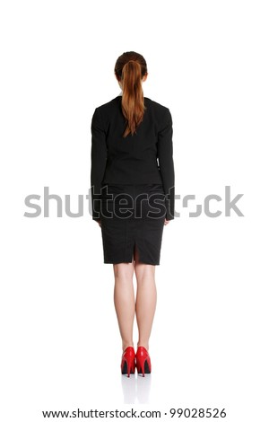 Business woman from the back - looking at something over a white background - stock photo