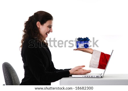 business woman getting a Christmas gift via the Internet - stock photo