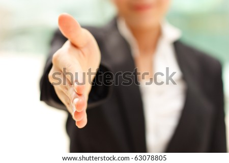 Business woman gives a handshake - stock photo