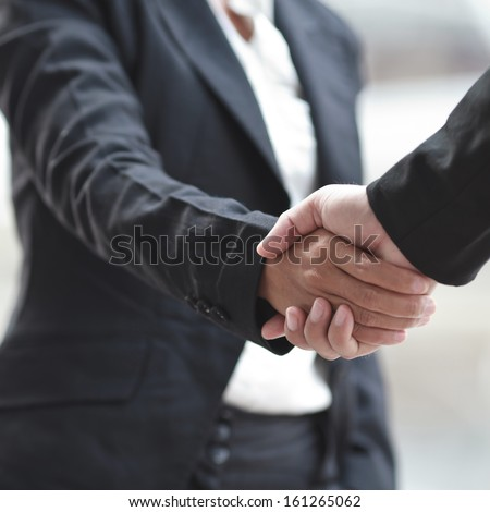 Business woman giving a handshake  - stock photo