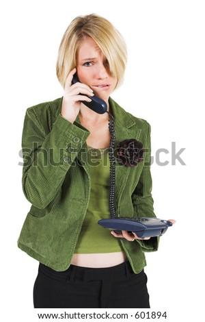 Business woman green jacket, talking  on the phone, looking stressed