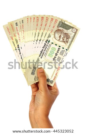 Business woman hand holding Indian five hundred rupee notes