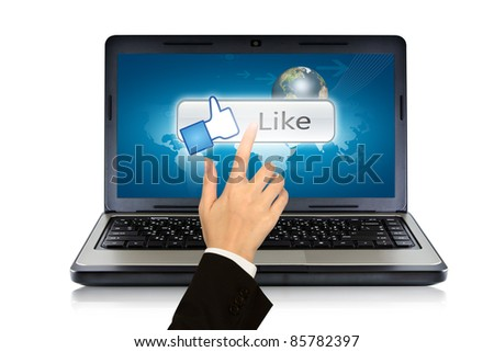 Business woman hand  press finger on Like button on screen laptop - stock photo