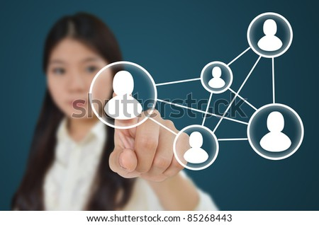 Business woman hand pressing social network icon on blue background