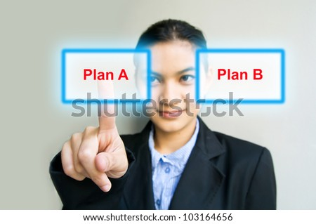 business woman hand pushing Plan A button - stock photo