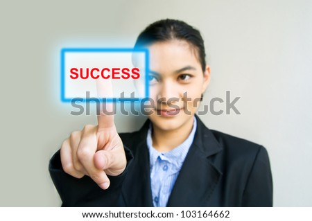 business woman hand pushing success button - stock photo