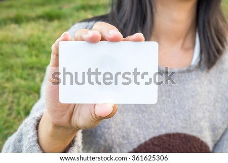 Business woman hand showing business card.Vintage tone,Retro filter effect,Soft focus,Low light.(selective focus) - stock photo