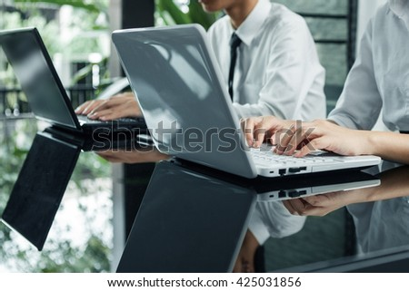 business woman hand typing on laptop keyboard - stock photo