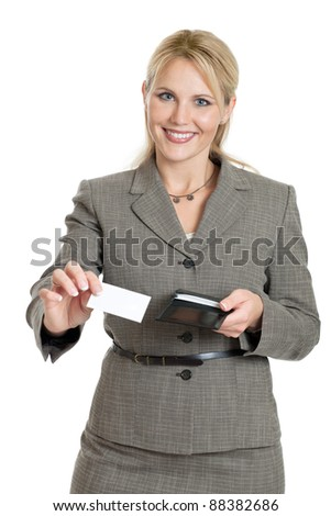 Business woman handing out her business card isolated on a white background - stock photo