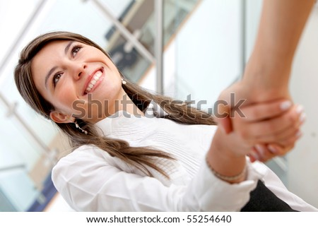 Business woman handshaking with an other person - stock photo