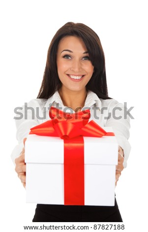 Business woman happy smile hold gift box in hands. Isolated over white background. - stock photo