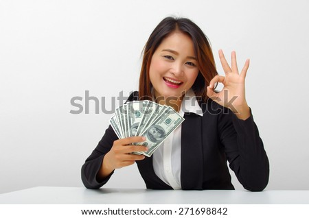 business woman happy with money - stock photo